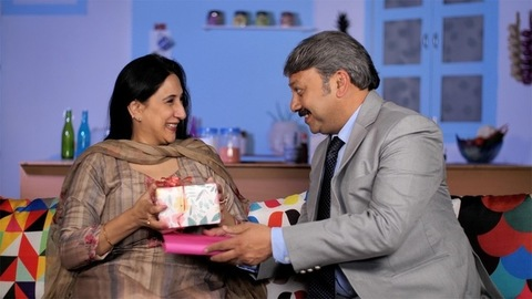 Affectionate husband gives a surprise gift to his wife - togetherness and bonding