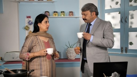 Attractive couple having tea and biscuits - bonding and togetherness