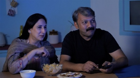 Excited middle-aged adults watching TV and having fun - togetherness and bonding