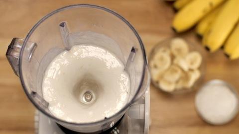 A slow motion of a refreshing banana drink made with milk and crystal sugar, Banana shake
