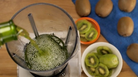 Pouring of a green liquid into a blender to make a cocktail - cooling summer drink, Mocktails India