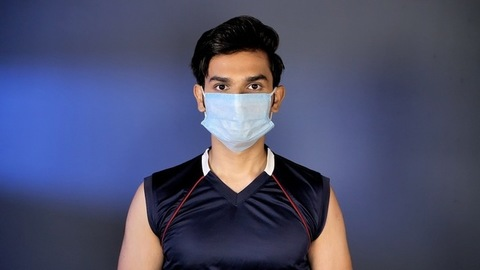 Indian youngster wearing a medical mask for protection from Coronavirus pandemic