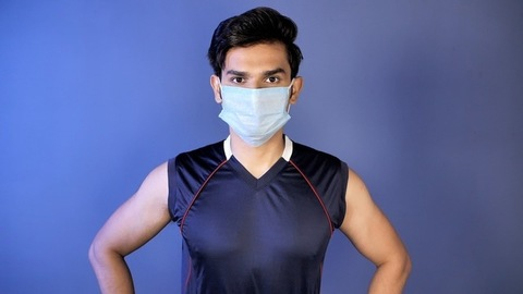 Fit and healthy man in a medical mask for protection from pollution and diseases