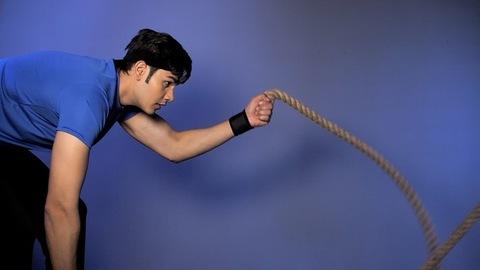 Indian youth enjoying healthy bodybuilding using battle ropes - intense workout