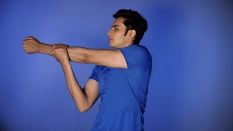 Handsome and muscular Indian athlete stretching his arms and muscles - a healthy lifestyle