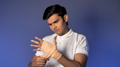 Sprain/injury on athlete's hand - Painful expression. Indian sportsman, Indian boxer