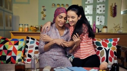 Female cancer patient after her chemotherapy spending some time with family
