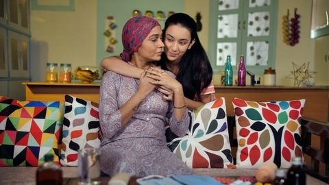 Young Indian daughter hugging her sick mother lovingly - love and care