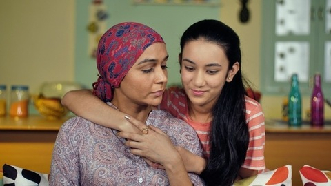 Lovely daughter taking care of her sick mother after chemotherapy sessions
