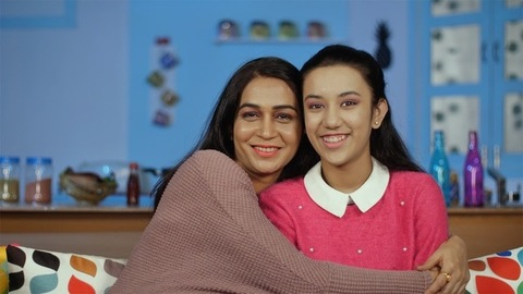 Caring and affectionate mother hugging her teenage daughter - family bonding