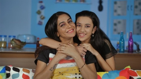 Cheerful girl giving a hug to her sad mom to make her happy - mother-daughter bonding