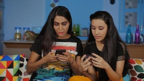 Indian teenage daughter helping her mother in online shopping - Mother Daughter Bonding