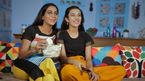 Mother-daughter enjoying their favorite program on television - leisure moment