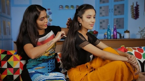 Indian loving mother doing the hair of her teenage daughter - Family bonding