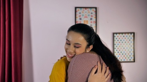 Cheerful teenage girl hugging an elderly Indian woman - special bonding