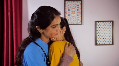 Teenage daughter giving a stethoscope to her doctor mother and embracing her