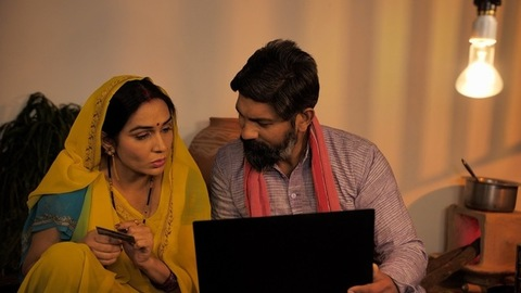 Indian village couple - Using the internet and doing online shopping