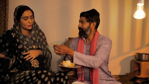 Caring Indian husband giving his wife nutritious fruits to eat during her pregnancy
