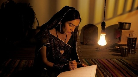 Rural women in traditional saree studying at the night - Women education and empowerment
