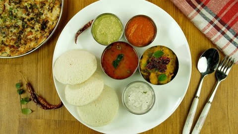 Top view shot of famous South Indian platter rotating on a wooden platform