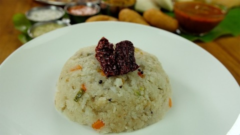 Closeup shot of beautifully served Upma in a white plate - South Indian cuisine