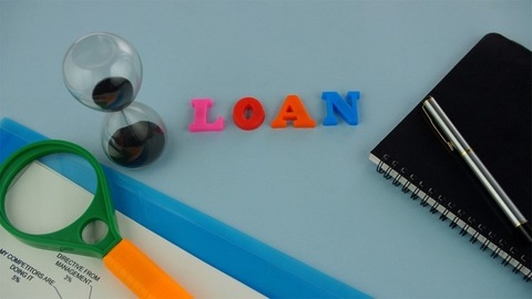 """Closeup shot of the word """"Loan"""" composed with colorful letters - microfinance concept"""