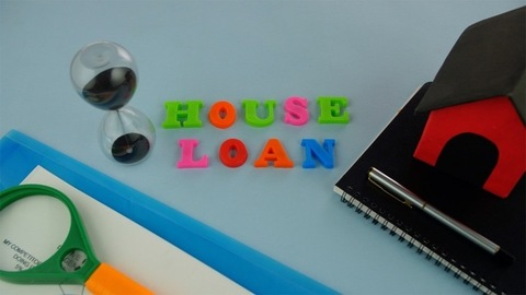 """Pan shot of """"House Loan"""" words composed with colorful letters - finance concept"""