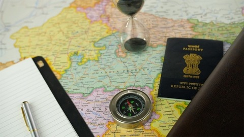 Pan shot of different travel accessories for planning a travel vacation to India