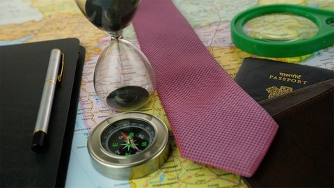 Closeup shot of travel planning accessories for a business trip - travel concept