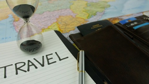 Closeup shot of travel planning accessories with map of India in the background