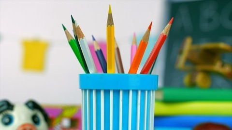 Closeup shot of different multi-colored pencils used in drawing and coloring