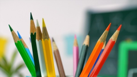 A collection of different multicolored school pencils used in drawing and coloring
