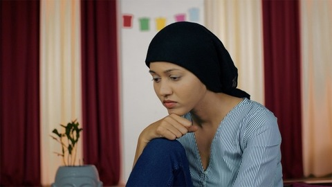 Sad and lonely cancer patient worried about her future after chemotherapy