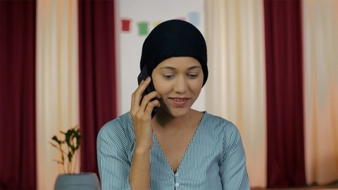 Portrait of a cheerful female patient with a headscarf - Cancer treatment