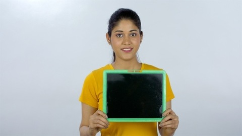 A smart woman with a blackboard/copy space for breast cancer awareness