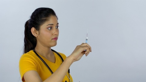 A young ambitious learner with a stethoscope and a medicine injection