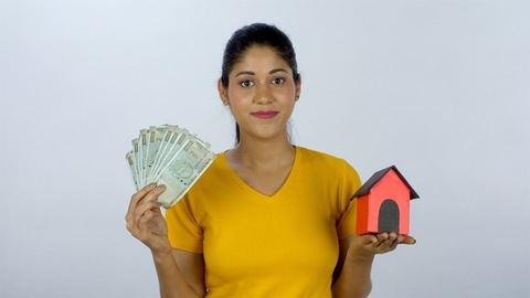 Ambitious working lady saving her money to buy a dream house for herself