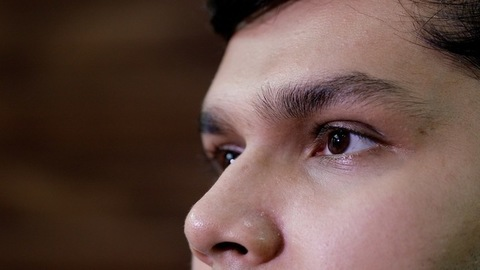 Extreme close up of a young teenager's eyes gazing at someone or something