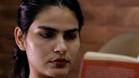 Closeup shot of a beautiful Indian girl reading her favorite novel - leisure time