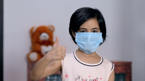 Portrait of a young girl using a medical mask during the Covid-19 pandemic time