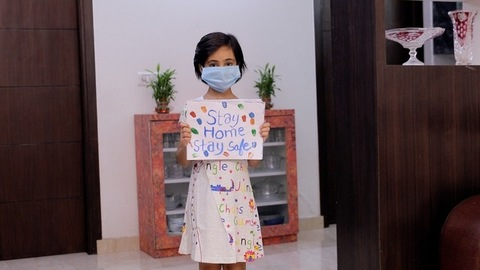 Long shot of a young girl wearing a surgical mask during the Covid-19 pandemic time