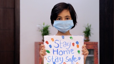 Portrait of a young girl wearing a surgical mask during the Covid-19 pandemic time