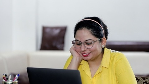 Indian woman having a video call via laptop - distance communication concept