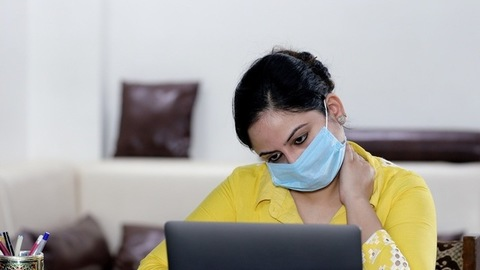 Young female doing work from home due to the outbreak of coronavirus in India