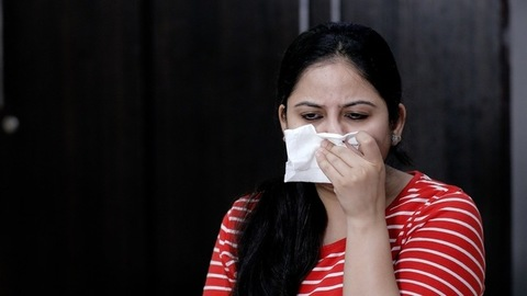 Portrait of an Indian girl suffering from cold - common symptoms of Covid-19