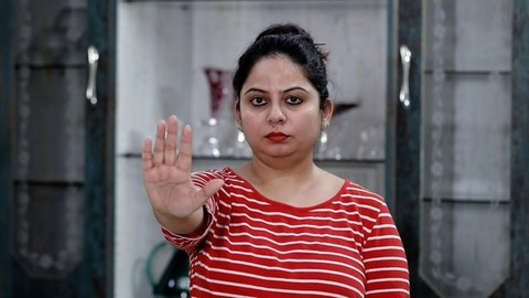 Indian female taking a stand for herself to stop violence - women abuse concept