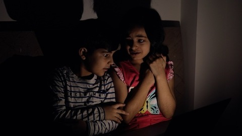 Cute brother and sister are frightened while viewing something unbelievable - Screen Time