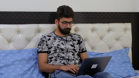 Young man doing work from home due to the outbreak of coronavirus in India