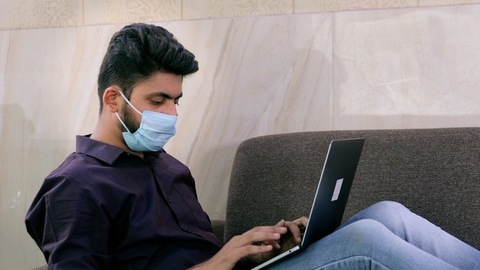 Young male doing work from home due to the outbreak of coronavirus in India