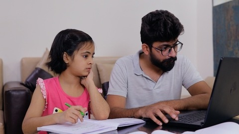 Young and single father helping his girl in studies during COVID pandemic at home